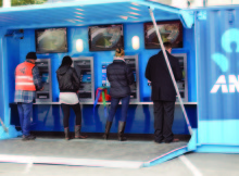 Fieldays visitors try out ANZ portable container bank.