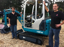 Territory manager for Endraulic Ltd, Allan Gudsell (left), and sales manager, Blair Sargison, with the same brand of digger that has been listed for one dollar on Trademe.
