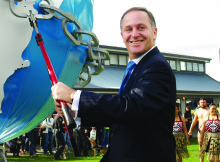 """Prime Minster John Key cut the opening chains of Fieldays symbolising the year's theme """"Breaking barriers to productivity"""""""
