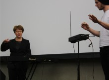 Lydia Kavina leads a music student through the first stages of playing a theremin