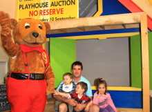 Chris Young with Hayley, Lochy and Campbell are delighted with their new playhouse