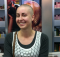 Close shave: Katie Levendis after shaving her blonde locks for famine victims