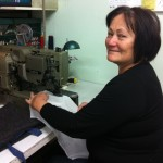 Sewing On: Dot Hunter has reopened her business after losing everything to the Samoan tsunami. Picture: Monica Tischler