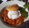 Cannellini beans in tomato sauce topped with a poached egg at Metropolis. Photo: Mackenzie Mccarty