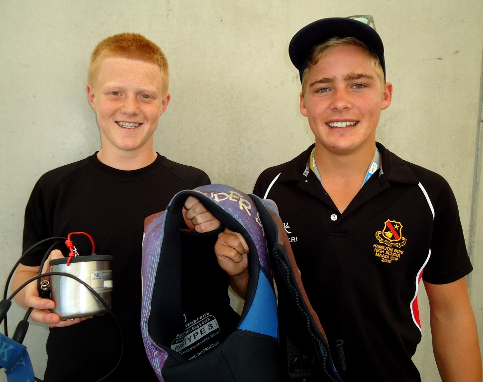 HANDOVER: Coxswain Jack Donaldson hands over his gear to Finley Deller, before the novelty race.