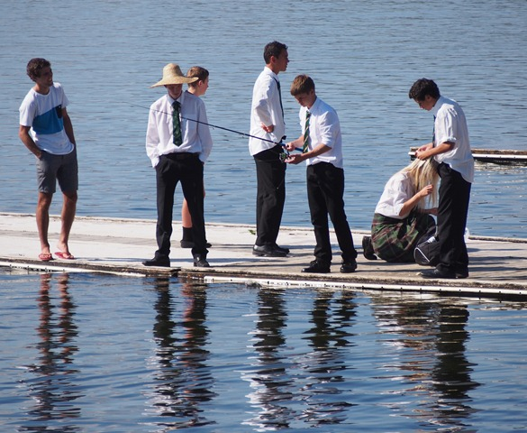 HOOKED: Wanganui High School students fishing during some down time at Maadi. Photo: Ali Brady