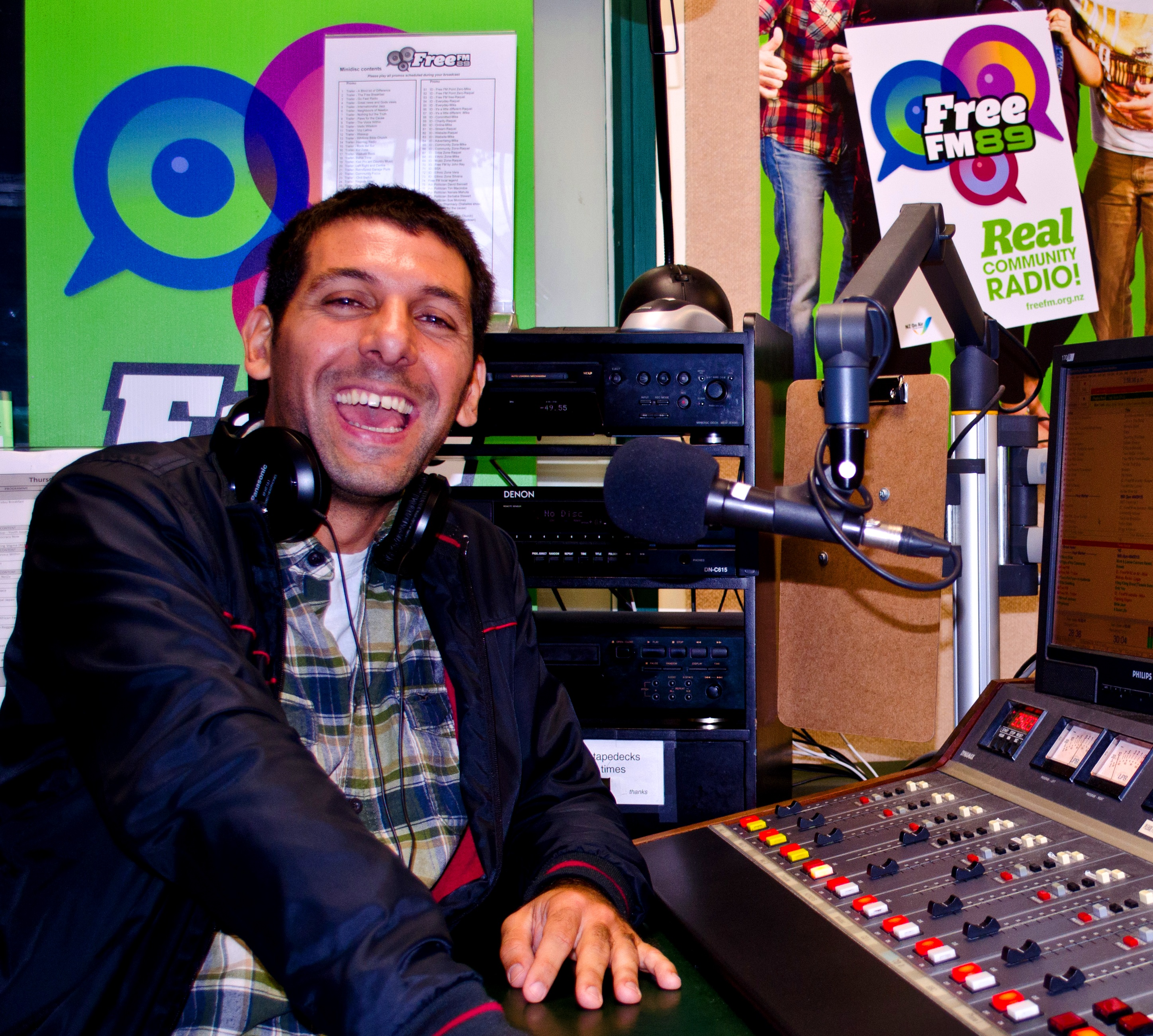 ON AIR: Juan Martinez prepares for his long show in the Free FM studio.