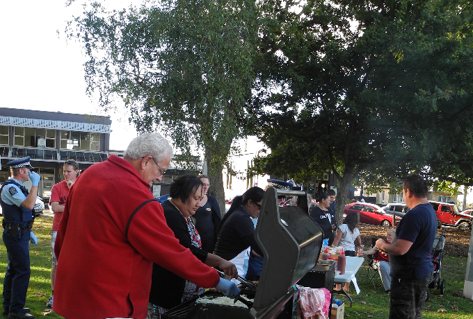 HELPING HANDS: Volunteers for the cook, local organisations and Hamilton police cook sausages to help fundraise for the playground