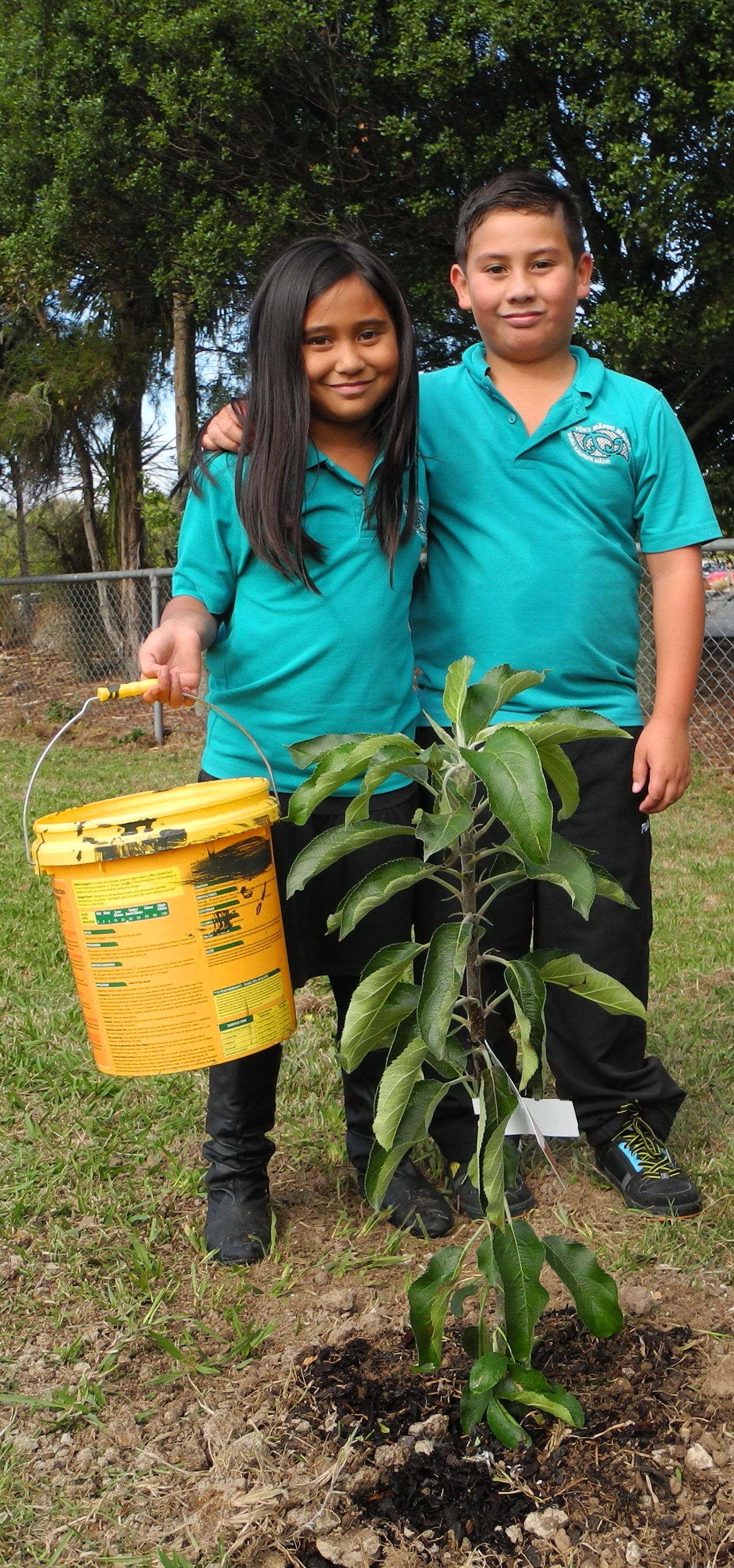 LINKING BACK TO ROOTS: Pounamu Kora and Te Maia Kora happy with their tree PHOTO: Jayden Parker