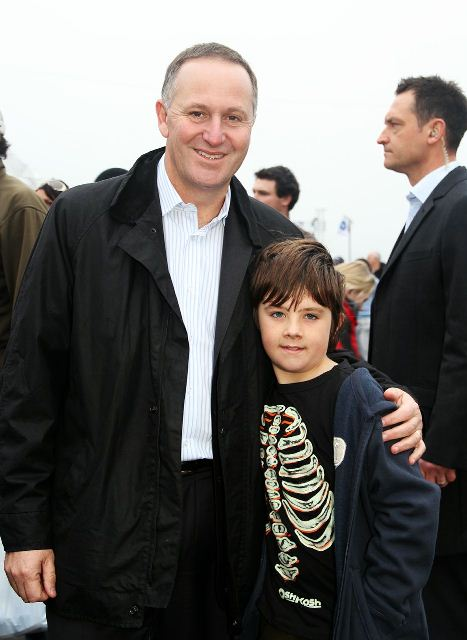 PM EMBRACES: John Key stops to take a photo with seven-year-old Christian Stark from Tauranga. Photo: Mengchen Wang