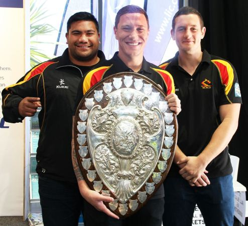MEGA SHIELD: Waikato rugby players Teddy Tauroa, Decklan O'Dannall, and Rory Grice brought the Ranfurly Shield to Fieldays. Photo: Grace Hodge.