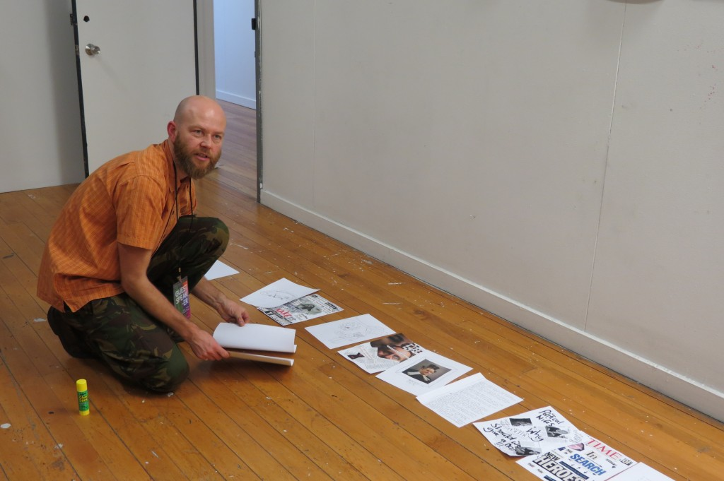 Creating the master copy of one of the zines by gluing the a4 sheets onto the booklet made from a3s folded in half