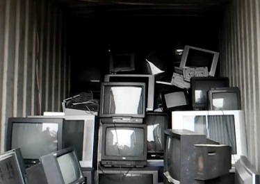 PILE UP: Non-digital-ready televisions ready to be shipped off for recycling. Photo: Libby Wilson