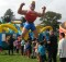 SCHOOL HOLIDAY FUN: Children line up at each of the Inflatables on offer. Photo: Shontelle Cargill