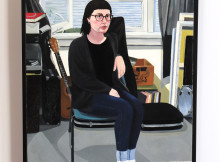 Priscilla McIntosh's portrait of herself in a cardigan and thick socks has reached the finals of the Adam Portraiture Award. PHOTO supplied.