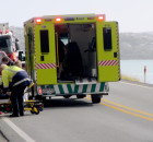 Traffic is diverted to one lane north of Wellington as a woman in a neck brace is loaded into an ambulance. Photo: Rachel Binning
