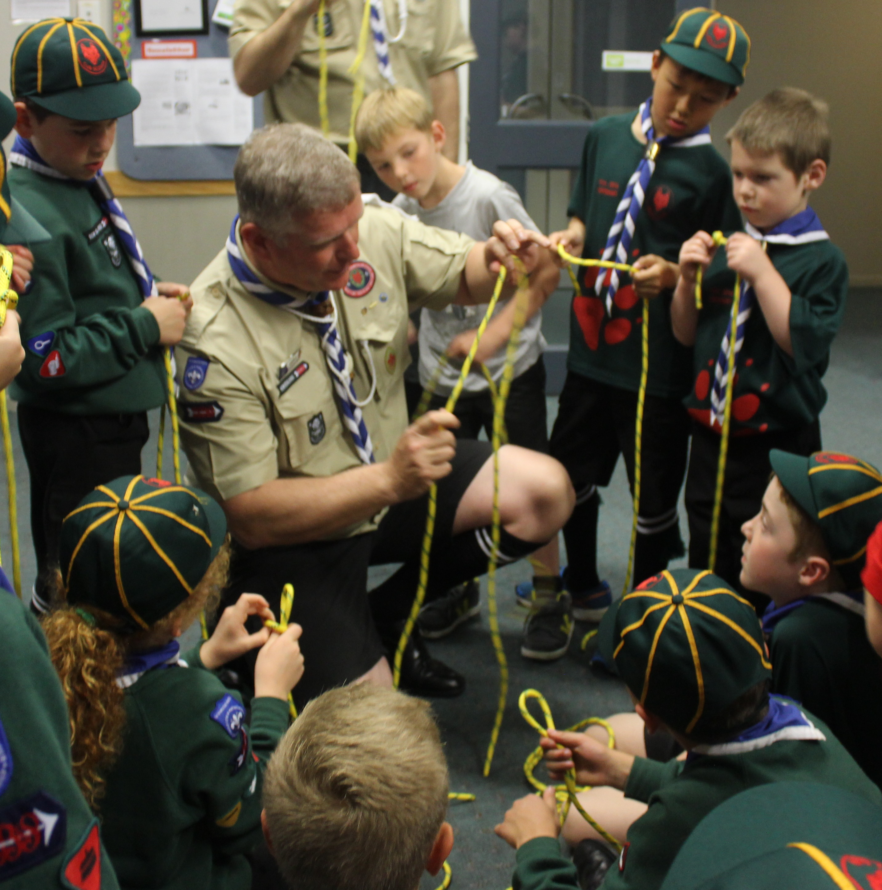 Paul Nimmo, Akela, demonstrating Knot-tying activity to the cubs Photo by: Maxx Alcobilla